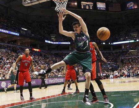 Milwaukee Bucks forward Ersan Ilyasova loses the ball as he drives to the basket against the Toronto Raptors during the second half of their NBA basketball game in Milwaukee, Wisconsin March 2, 2013. REUTERS/Darren Hauck