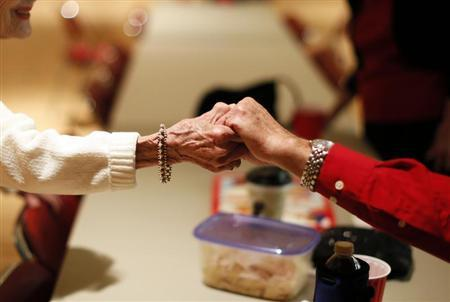 Retirees greet each other at a Saturday night dance in Sun City, Arizona, January 5, 2013. REUTERS/Lucy Nicholson