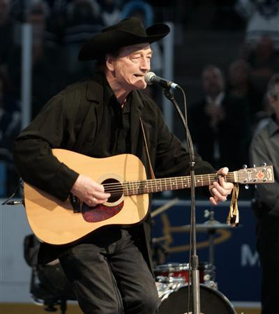 Canadian singing legend Stompin' Tom Connors sings ''The Hockey Song'' before the start of the NHL game between the Toronto Maple Leafs and the Ottawa Senators in Toronto in this October 5, 2005 file photo. Connors died March 6, 2013, aged 77. REUTERS/Mike Cassese/Files
