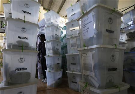 An official from the Independent Electoral and Boundaries Commission (IEBC) inspects ballot boxes at Kasarani gymnasium in Kenya's capital Nairobi March 5, 2013. REUTERS/Steve Crisp
