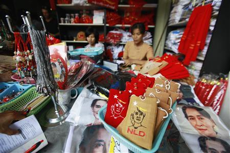 A party member sells party uniforms and memorabilia at the National League for Democracy (NLD) stand at the party's head office in Yangon March 7, 2013. REUTERS/Soe Zeya Tun