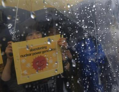 An anti-nuclear protester attends a rally against a possible restart of nuclear reactors, in front of Japanese Prime Minister Yoshihiko Noda's official residence in Tokyo in this June 16, 2012 file photo. The crowds of anti-nuclear protesters have dwindled since Japan's ''Summer of Discontent'' last year, and a new government is keen to revive the country's atomic energy industry. REUTERS/Kim Kyung-Hoon