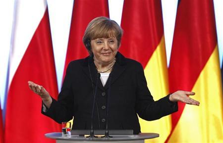 Germany's Chancellor Angela Merkel gestures during a news conference at the Visegrad Group meeting in Warsaw March 6, 2013. REUTERS/Peter Andrews