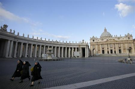 Nuns walk in Saint Peter's Square at the Vatican March 3, 2013. REUTERS/Max Rossi