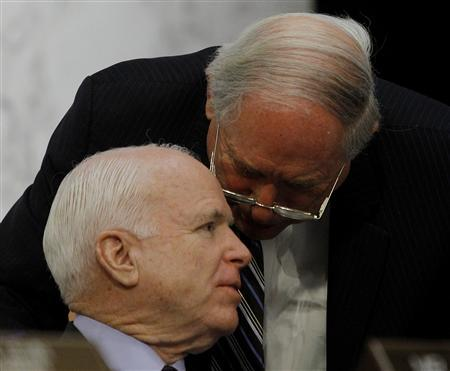 Chairman of the Senate Armed Services Committee Senator Carl Levin (D-MI) confers with committee member Senator John McCain (R-AZ) (L) in Washington March 5, 2013, during hearings on the Defense Authorization Request for fiscal year 2014. REUTERS/Gary Cameron