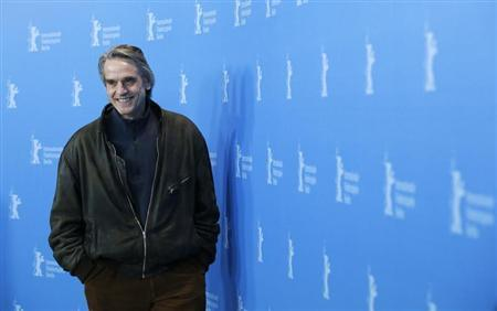 Actor Jeremy Irons smiles during a photocall to promote the movie ''Night Train to Lisbon'' at the 63rd Berlinale International Film Festival in Berlin February 13, 2013. REUTERS/Tobias Schwarz