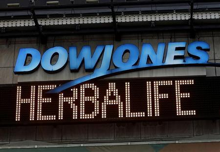 A news headline displaying ''Herbalife'' is seen under the DowJones electronic ticker at Times Square in New York January 9, 2013. REUTERS/Shannon Stapleton