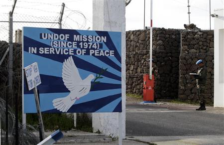 Indian United Nations peacekeepers stand at the gate to a U.N. base near the Kuneitra border crossing between Israel and Syria, in the Israeli occupied Golan Heights March 7, 2013. Israel voiced confidence on Thursday that the United Nations could secure the release of U.N. peacekeepers seized by Syrian rebels near the Golan Heights, signalling it would not intervene in the crisis. Israel captured the Golan Heights in the 1967 Middle East war and annexed it in 1981 in a move not recognized internationally. REUTERS/Baz Ratner