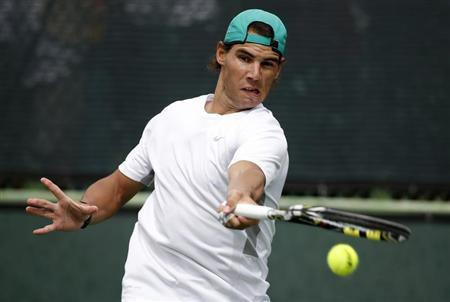 Rafael Nadal of Spain hits the ball during a practice session at the BNP Paribas Open ATP tennis tournament in Indian Wells, California, March 7, 2013. REUTERS/Danny Moloshok