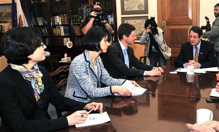 Representatives from the ''troika'' of lenders, (L-R) the European Central Bank's Isabel von Koppen Mertes, the International Monetary Fund's Delia Velculescu, and the European Commission's Maarten Verwey meet Cyprus President Nicos Anastasiades (R) in Nicosia, March 7, 2013. REUTERS/Yiannis Nisiotis