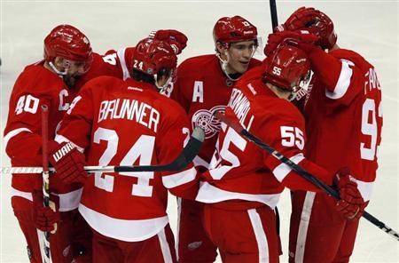 Detroit Red Wings players celebrate with teammate Niklas Kronwall (2nd R) after he scored the game winning goal against Edmonton Oilers goalie Nikolai Khabibulin during the third period of their NHL hockey game in Detroit, Michigan February 9, 2013. REUTERS/Rebecca Cook