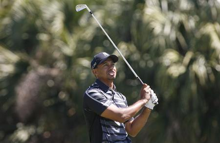 Tiger Woods of the U.S. watches his shot on the 13th tee during first round play in the 2013 WGC-Cadillac Championship PGA golf tournament in Doral, Florida March 7, 2013. REUTERS/Andrew Innerarity