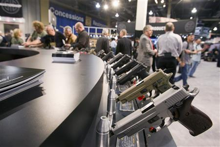 Sig Sauer handguns are displayed during the annual SHOT (Shooting, Hunting, Outdoor Trade) Show in Las Vegas January 15, 2013. REUTERS/Las Vegas Sun/Steve Marcus