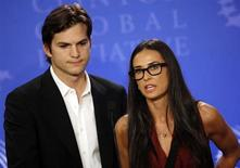 "Actors Ashton Kutcher (L) and Demi Moore announce the launch of their ""Real Men"" campaign at a news conference during the Clinton Global Initiative in New York September 23, 2010. REUTERS/Chip East"