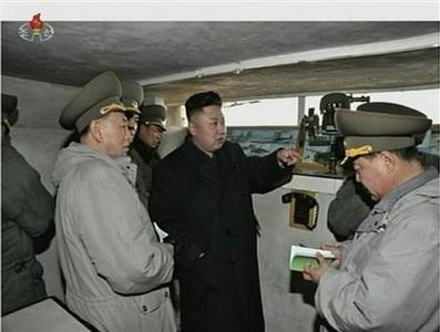 North Korean leader Kim Jong-un (C) speaks with senior military officials at an undisclosed location, in this still image taken from video shown by North Korea's state-run television KRT on March 8, 2013. REUTERS/KRT via Reuters TV