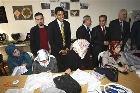 U.S. Agency for International Development (USAID) Administrator Rajiv Shah (2nd L) meets with Syrian refugees during his visit at a refugee camp named ''Container City'' on the Turkish-Syrian border in Oncupinar in Kilis province, southern Turkey, November 27, 2012. REUTERS/Adem Altan/Pool