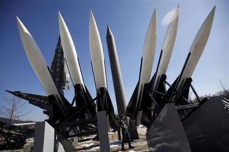 A visitor walks past North Korea's Russian made Scud-B ballistic missile (C in grey) and South Korea's U.S. made Hawk surface-to-air missiles at the Korean War Memorial Museum in Seoul February 15, 2013. REUTERS/Kim Hong-Ji/Files