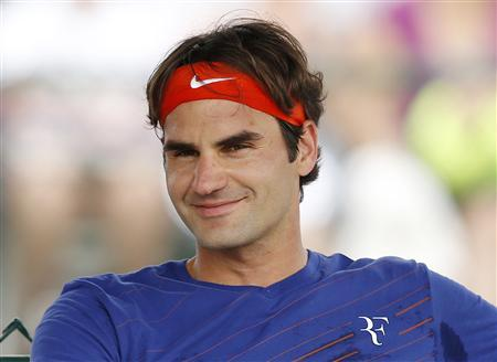 Roger Federer of Switzerland smiles while taking a break during practice at the BNP Paribas Open ATP tennis tournament in Indian Wells, California, March 7, 2013. REUTERS/Danny Moloshok