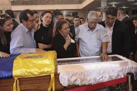 Relatives of Venezuela's late President Hugo Chavez, his brother Adan (2nd L), his mother Elena Frias (4th L) and his father Hugo (2nd R), cry as they view his coffin during a wake at the military academy in Caracas March 7, 2013, in this picture provided by the Miraflores Palace. REUTERS/Miraflores Palace/Handout