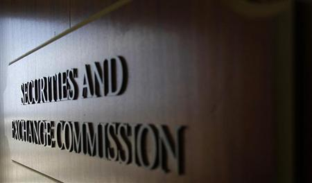 A sign for the Securities and Exchange Commission (SEC) is pictured in the foyer of the Fort Worth Regional Office in Fort Worth, Texas June 28, 2012. Picture taken June 28, 2012. REUTERS/Mike Stone