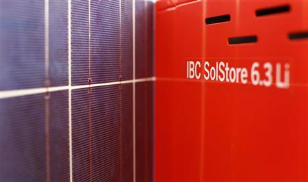A photovoltaic (solar) panel is seen next to solar battery memory system 'IBC SolStore 6.3 Li' in the IBC Solar headquarters in Bad Staffelstein March 5, 2013. REUTERS/Michaela Rehle