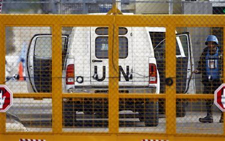 A Filipino United Nations peacekeepers enters a car at the Kuneitra border crossing between Israel and Syria, close to the ceasefire line between the two countries, in the Israeli occupied Golan Heights March 8, 2013. REUTERS/Baz Ratner