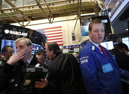 Traders work on the floor of the New York Stock Exchange March 5, 2013. The Dow surged to a new record on Tuesday, breaking through levels last seen in 2007 as investors extended 2013's rally. REUTERS/Brendan McDermid (UNITED STATES - Tags: BUSINESS)