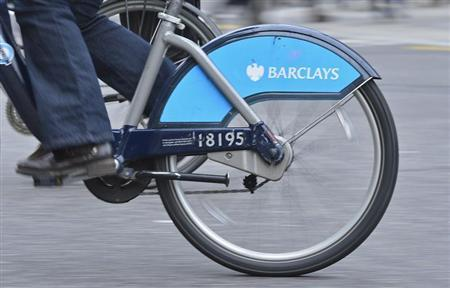 The Barclays logo is seen on a rental bike being ridden by a commuter in London February 12, 2013. REUTERS/Toby Melville