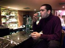 A customer at Buchans Bar in London takes a sip of Absinthe, December 10. REUTERS/Kieran Doherty