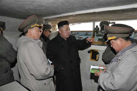North Korean leader Kim Jong-Un (C) talks with officers at a guard post during his visit to the Jangjae Islet Defence Detachment and Mu Islet Hero Defence Detachment on the front, near the border with South Korea, southwest of Pyongyang March 7, 2013 in this picture released by the North's official KCNA news agency in Pyongyang March 8, 2013. REUTERS/KCNA