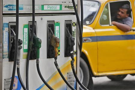 A driver waits in a taxi for his turn to fill up his tank with diesel at a fuel station in Kolkata June 14, 2012. REUTERS/Rupak De Chowdhuri