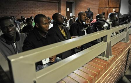 South African police officers arrested on suspicion of murder appear for bail hearing at Benoni court, east of Johannesburg March 8, 2013. REUTERS/Werner Beukes/Pool