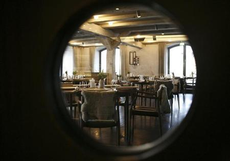 The interior of Rene Redzepi's Noma restaurant is seen through a window in Copenhagen December 12, 2009. REUTERS/Christian Charisius