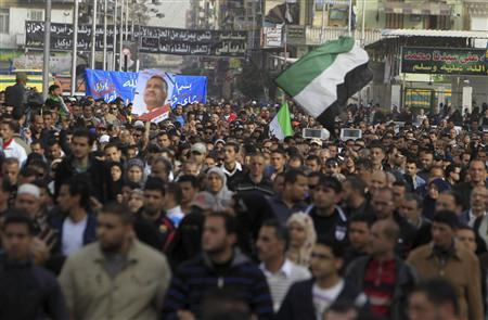 People against Egyptian President Mohamed Mursi attend the funeral of Ahmed Galal, who died during clashes between police and demonstrators, in Port Said city, 170 km (106 miles) northeast of Cairo, March 8, 2013. REUTERS/Mohamed Abd El Ghany