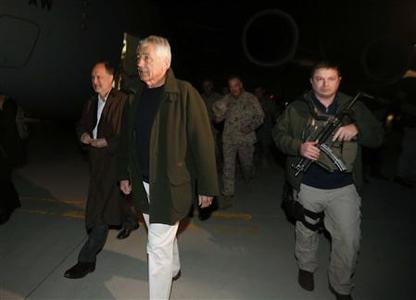 U.S. Secretary of Defense Chuck Hagel walks with U.S. Ambassador to Afghanistan James Cunningham (L) and General Joseph Dunford (background), Commander of the International Security Force, upon Hagel's arrival in Kabul, Afghanistan, March 8, 2013. It is Hagel's first official trip since being sworn-in as Obama's Defense Secretary. REUTERS/Jason Reed