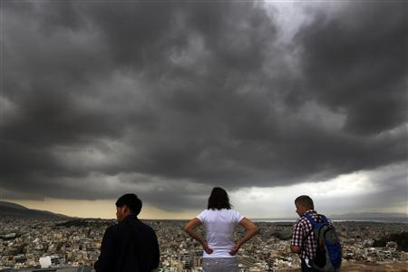 Tourists have a bird's eye view of Athens from atop the ancient hill of the Acropolis during a rainy day October 29, 2012. REUTERS/Yannis Behrakis