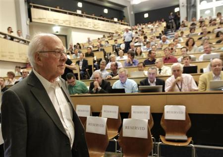 British physicist Peter Higgs arrives for a scientific seminar to deliver the latest update in the search for the Higgs boson at the European Organization for Nuclear Research (CERN) in Meyrin near Geneva July 4, 2012. REUTERS/Denis Balibouse/Files