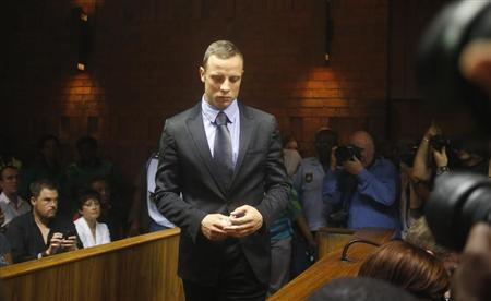 Oscar Pistorius enters the dock during a break in court proceedings at the Pretoria Magistrates court, February 21, 2013. REUTERS/Mike Hutchings