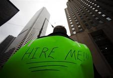 A man, with a sign strapped to his back, uses a megaphone to attract the attention of potential employers as he hands out resumes on Bay Street in the financial district in Toronto, March 5, 2009. REUTERS/Mark Blinch