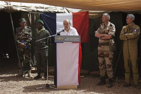 France's Defence Minister Jean-Yves Le Drian (C) speaks to French soldiers at a French military encampment at a Malian air base in Gao March 7, 2013. REUTERS/Joe Penney