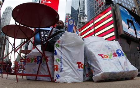 A woman is surrounded by shopping bags as she takes a break from holiday shopping in New York City's Times Square December 23, 2011 two days ahead of the Christmas holiday. REUTERS/Mike Segar