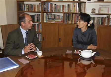 Tomas Ojea Quintana, U.N. special envoy on human rights in Myanmar, meets with Myanmar pro-democracy leader Aung San Suu Kyi (R) in Suu Kyi's home in Yangon February 16, 2013, in this picture provided by NLD. REUTERS/NLD/Handout