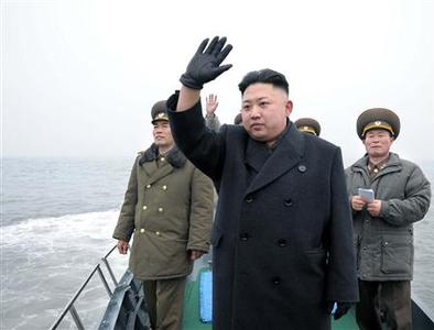 North Korean leader Kim Jong-Un (C) waves from a boat during his visit to the Jangjae Islet Defence Detachment and Mu Islet Hero Defence Detachment on the front, near the border with South Korea, southwest of Pyongyang March 7, 2013 in this picture released by the North's official KCNA news agency in Pyongyang March 8, 2013. REUTERS/KCNA