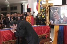 Iran's President Mahmoud Ahmadinejad pays tribute to late Venezuelan President Hugo Chavez, during the funeral service at the Military Academy in Caracas March 8, 2013, in this picture provided by the Miraflores Palace. REUTERS/Miraflores Palace/Handout