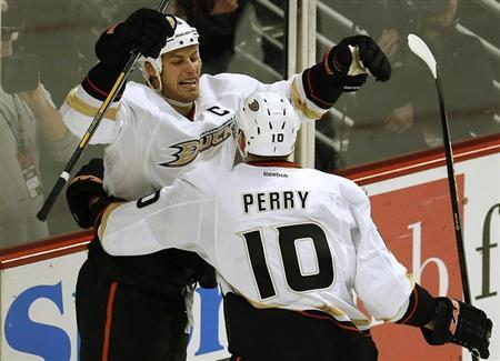 Anaheim Ducks' Ryan Getzlaf (L) celebrates his goal against the Chicago Blackhawks with teammate Corey Perry during the second period of their NHL hockey game in Chicago, February 12, 2013. REUTERS/Jim Young