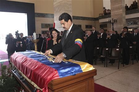 Venezuelan Vice-President Nicolas Maduro lays a replica of the Simon Bolivar's sword on the coffin of Venezuela's late President Hugo Chavez at the Military Academy in Caracas March 8, 2013, in this picture provided by the Miraflores Palace. REUTERS/Miraflores Palace/Handout