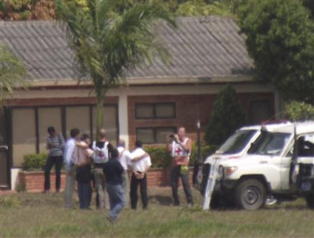 Two Germans (3rd L, with cap, and back 3rd R, in white shirt) pose for a picture after being released by Colombia's second-largest guerrilla group, the National Liberation Army (ELN), to the International Red Cross Committee (ICRC), at the airport in Ocana in northeast Norte de Santander province, in this picture provided by La Opinion newspaper and taken March 8, 2013. REUTERS/La Opinion Newspaper/Handout