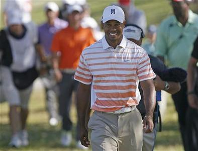 Tiger Woods of the U.S. walks to the 11th tee following a birdie during second round play in the 2013 WGC-Cadillac Championship in Doral, Florida March 8, 2013. REUTERS/Andrew Innerarity