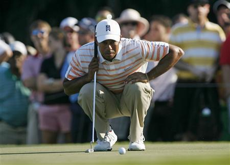 Tiger Woods of the U.S. looks at his putt on the 13th hole during second round play in the 2013 WGC-Cadillac Championship PGA golf tournament in Doral, Florida March 8, 2013. REUTERS/Andrew Innerarity