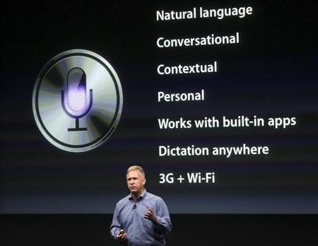 Philip Schiller, Apple's senior vice president of Worldwide Product Marketing, speaks about Siri voice recognition and detection on the iPhone 4S at Apple headquarters in Cupertino, California October 4, 2011. REUTERS/Robert Galbraith